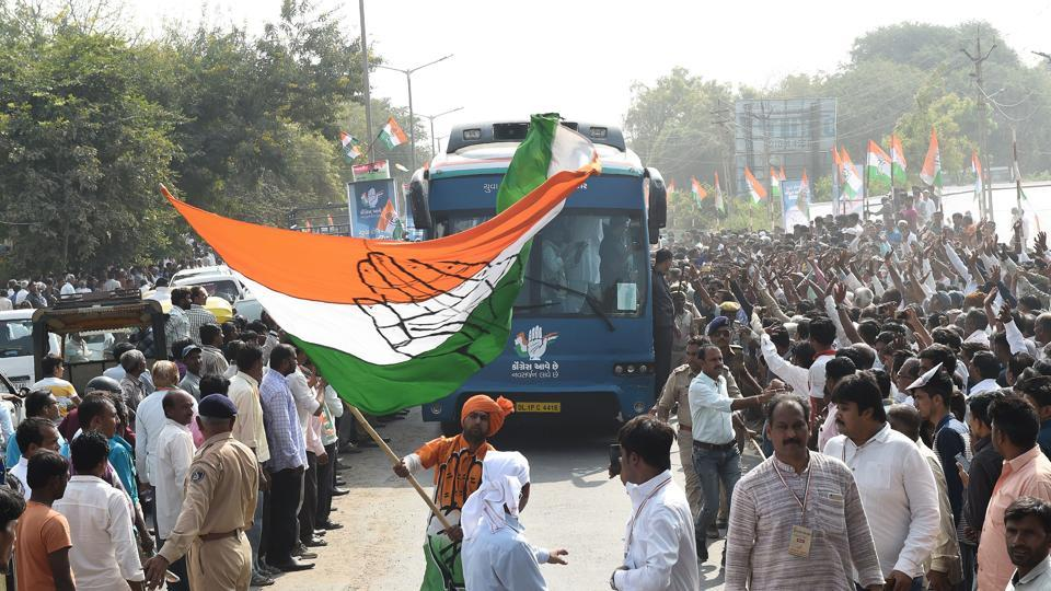 Congress supporter waves a party flag at Prantij town, 65 km from Ahmedabad.
