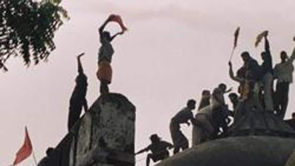 Hindu fundamentalists celebrate the destruction of the 16th Century Babri Mosque in Ayodhya, December 6, 1992.  It sparked riots in which more than 2,000 people were killed.
