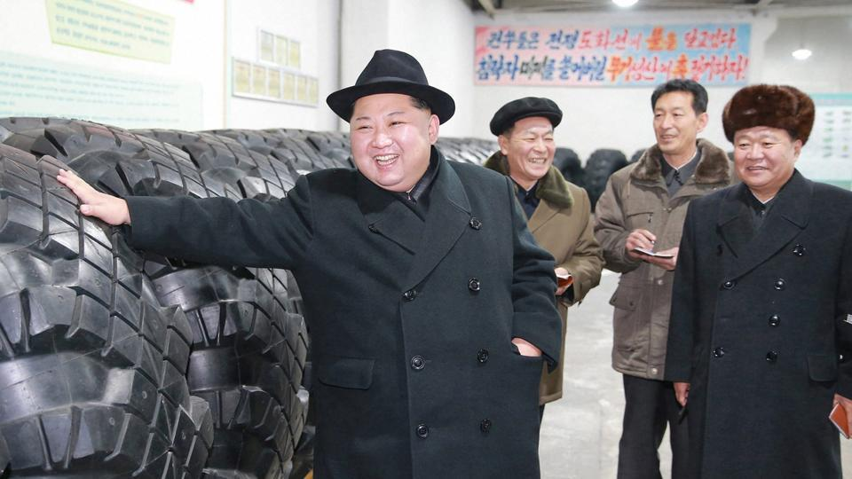 North Korean leader Kim Jong Un inspects a tyre factory in North Korea. Kim thanked workers at a factory that built the tyres for a huge vehicle used to transport a new intercontinental ballistic missile that was test-launched this week.
