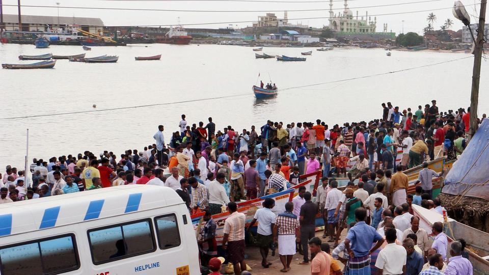 Huge crowd of fishermen families wait for those who yet to return home at Vizhinjam harbour in Thiruvananthapuram on Saturday.
