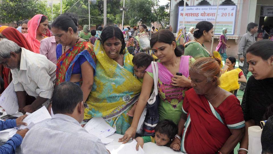 People queue up at  Bhamashah Yojna camp in Rajasthan's Jaipur.