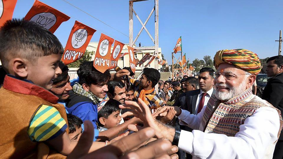 Prime minister Narendra Modi meet people during his election campaign for the forthcoming Gujarat assembly polls, in Bhuj.