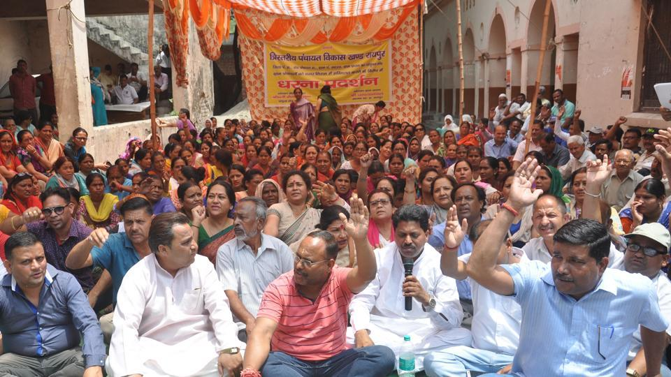 "Representatives of 60 villages under the banner of  ""Save Village Committee"" protesting  in front of the Dehradun Municipal Corporation against the proposed inclusion of the villages within the city civic body."