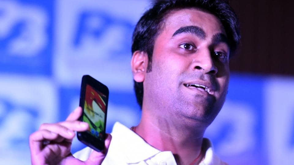 Mohit Goel, director of Ringing Bells Pvt Ltd, shows Freedom 251 smartphone, priced at Rs. 251 at a press conference on July 7, 2016 in New Delhi.