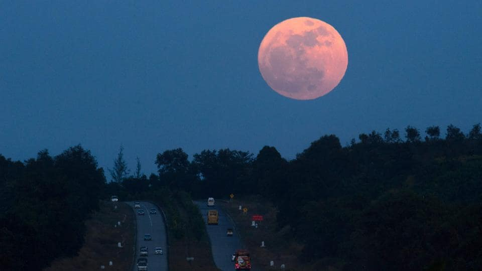 The supermoon rises over a highway near Yangon, Myanmar , on Sunday.