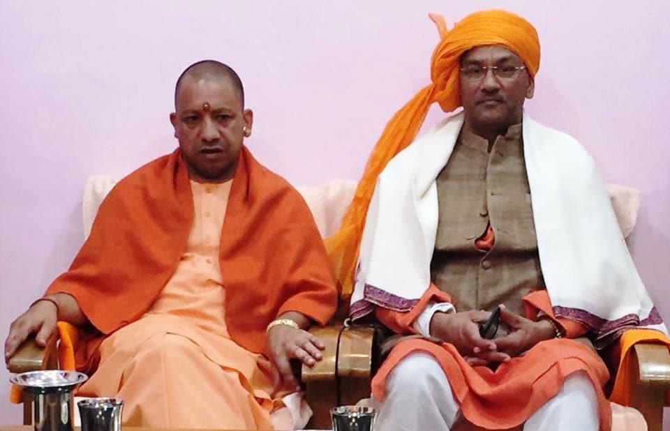 Uttarakhand chief minister TS Rawat wth his UP counterpart Yogi Adityanath in Gorakhpur on Monday.