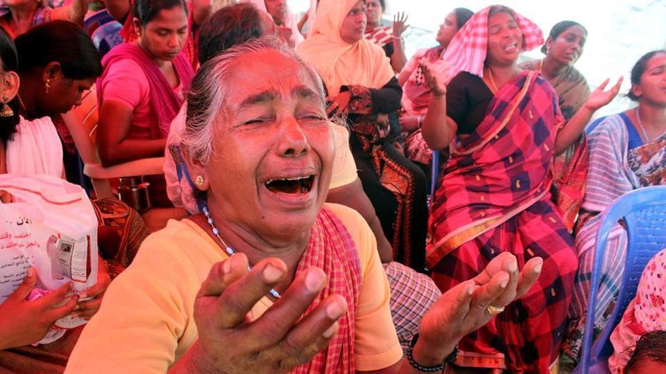 Relatives of fishermen grieve in Thiruvananthapuram,Kerala, on Sunday.