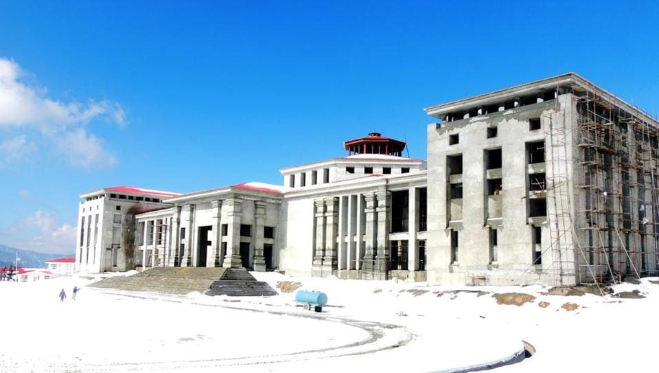 The snow-covered state assembly building at Bhararisain near Gairsain in Chamoli district, where winter session is set to begin on December 7.