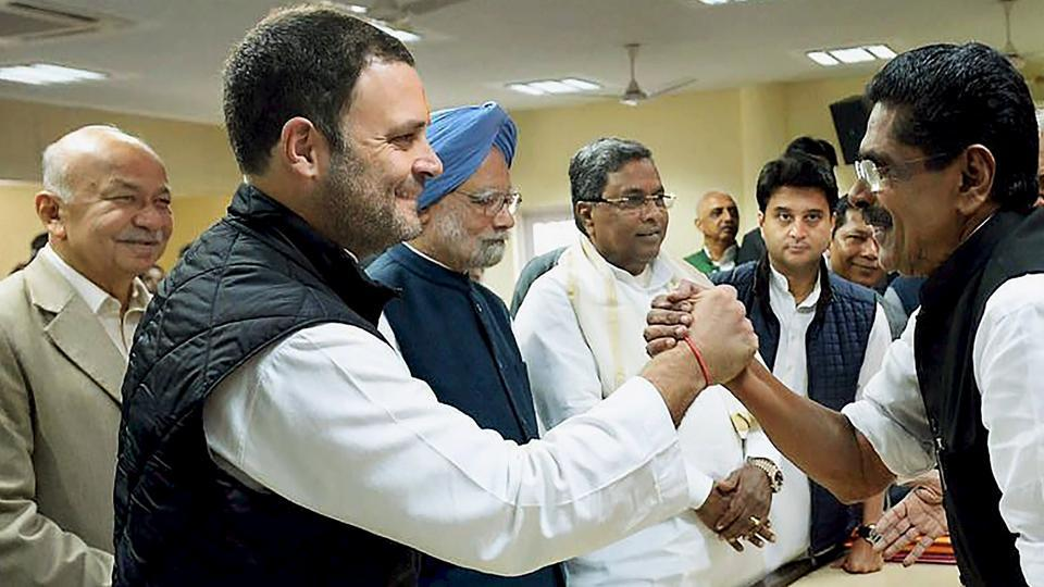 Congress vice president Rahul Gandhi is greeted by a party colleague after filing his nomination for the party president's post on New Delhi on Monday. Also, seen are former prime minister Manmohan Singh, Congress MP Jyotiraditya Scindia and Karnataka chief minister Siddaramaiah.