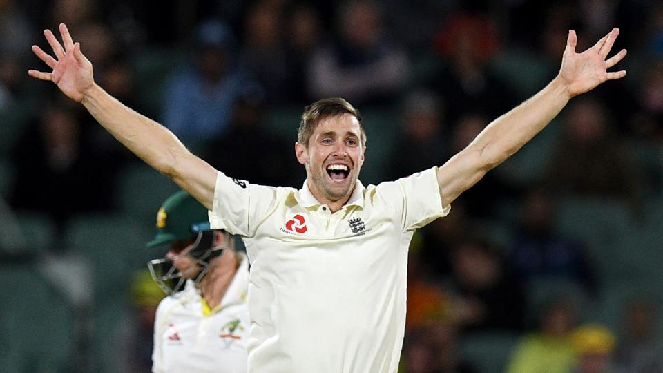 England's Chris Woakes celebrates dismissing Australia's Steve Smith on the third day of the second Ashes Test in Adelaide. The all-rounder believes England still have a chance at winning the Test and levelling the series.