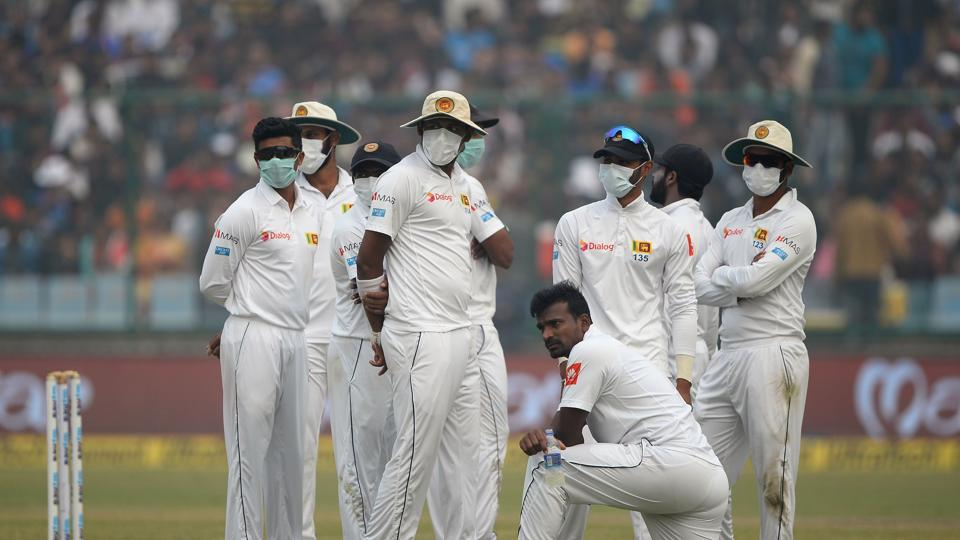 Sri Lanka cricket players wear masks in an attempt to protect themselves from air pollution during the second day of the third Test cricket match between India and Sri Lanka at the Feroz Shah Kotla Cricket Stadium in New Delhi on December 3, 2017.