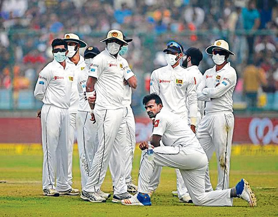 Sri Lanka cricket players wear masks in an attempt to protect themselves from air pollution during the second day of the third Test cricket match between India and Sri Lanka at the Feroz Shah Kotla Cricket Stadium in New Delhi on December 3.