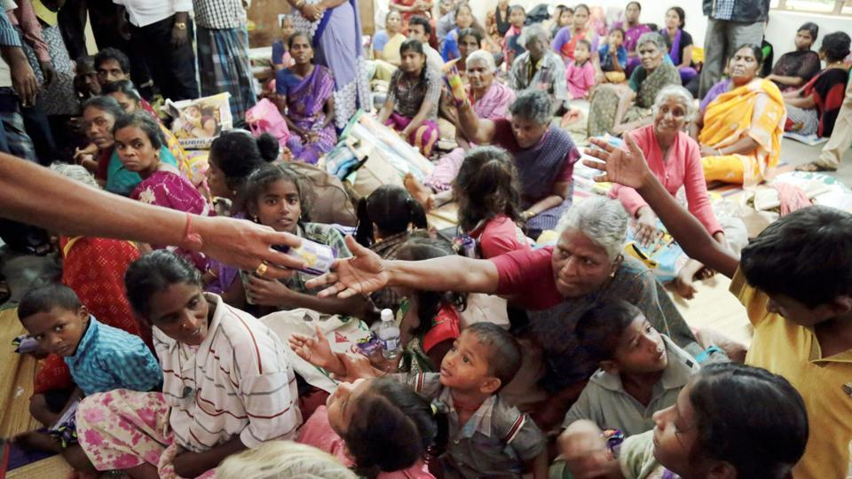 Displaced people receive essential supplies at a relief camp in the Kanyakumari district, Kerala on Saturday. The scale of the cyclone was reduced from 'very severe' on Sunday to 'severe', the weather department said. It has warned fisherman along the Maharashtra, Goa and Karnataka coastline not to venture into the sea from Monday to Wednesday. (PTI)