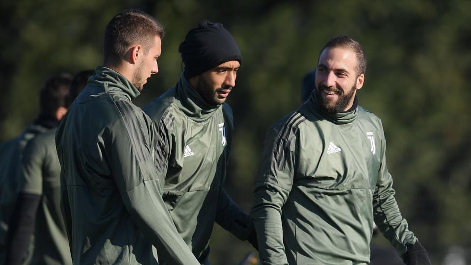 Juventus players take part in a training session on the eve of their UEFA Champions League match Olympiacos.