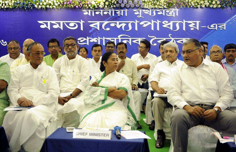West Bengal Chief Minister Mamata Banerjee in conversation with Chief Secretary Basudeb Bandopadhay (R) at the first administrative review meeting of her government in Kolkata on June 3, 2016.