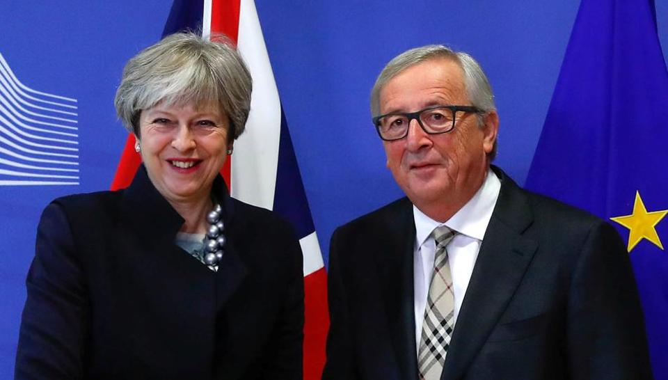 Britain's Prime Minister Theresa May with European Commission President Jean-Claude Juncker in Brussels on December 4, 2017.