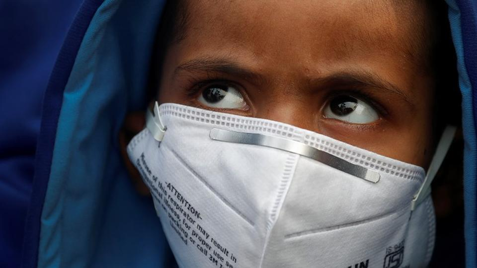 A child wears a face mask for protection from air pollution in Delhi.