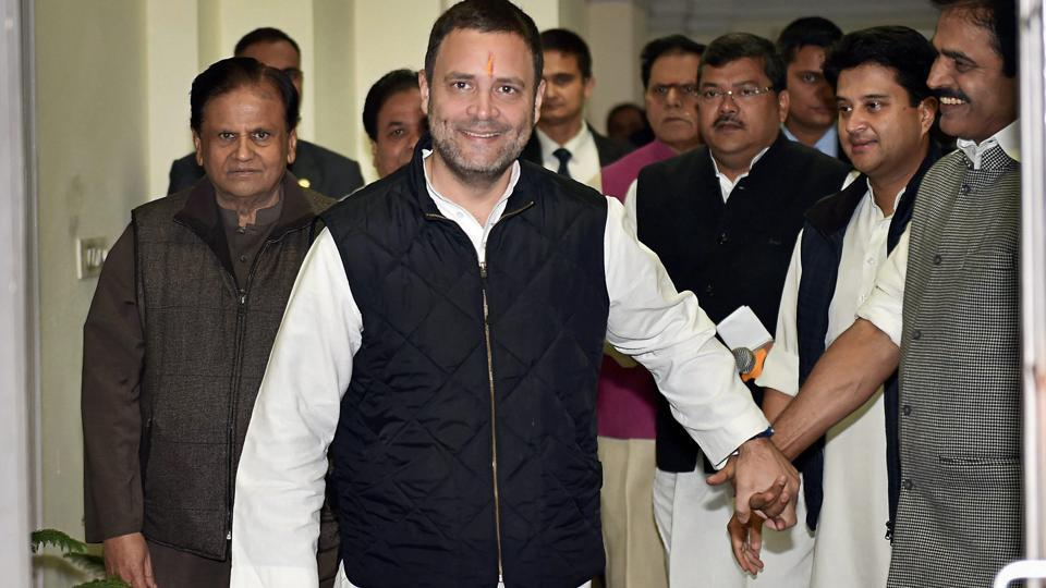 Congress vice president Rahul Gandhi, accompanied by senior party leaders, arrives to file his nomination papers for the post of party president, at the AICC office in New Delhi on Monday.