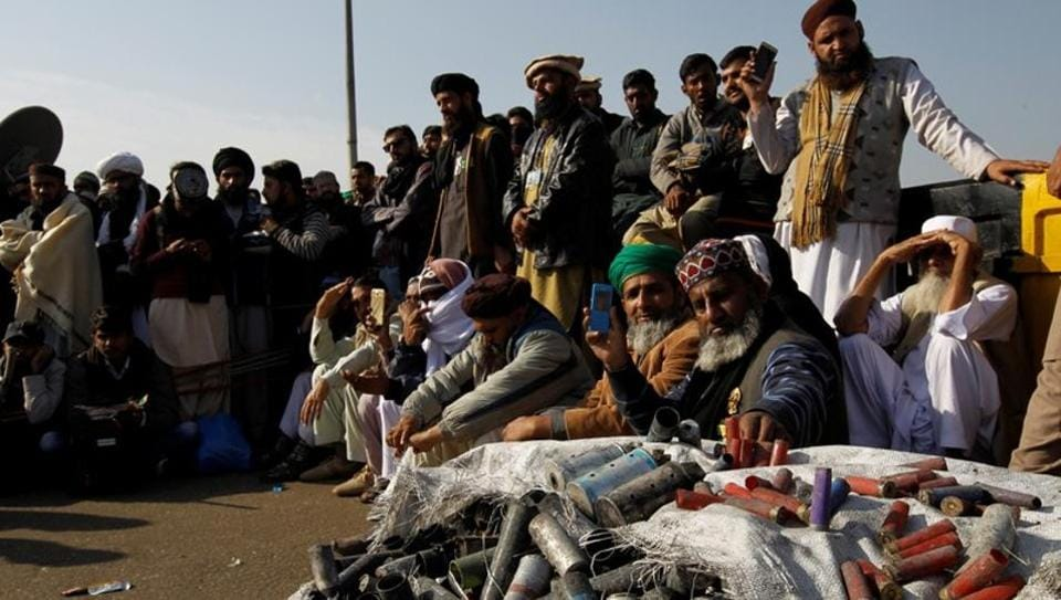 Supporters of the Tehrik-e-Labaik Pakistan Islamist political party, beside a sack full of shotgun and teargas shell casings used on them by police, at their protest site at Faizabad junction in Islamabad, Pakistan on November 27 2017