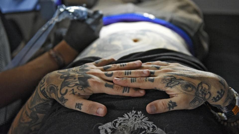 A festival attendee gets inked during the third edition of the Heartwork festival. (Burhaan Kinu / HT PHOTO)