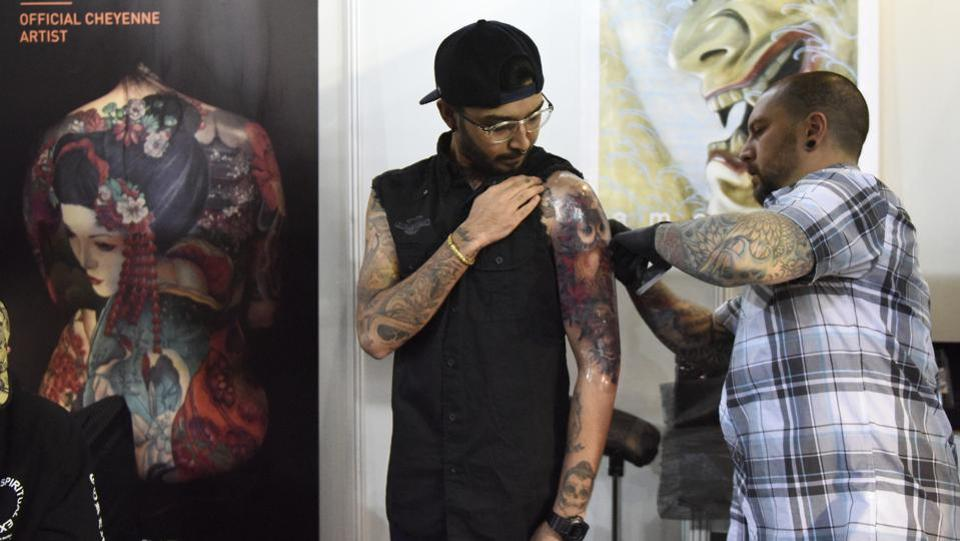 The third edition of Heartwork Tattoo Festival concluded on Sunday at Indira Gandhi Indoor Stadium with the participation of more than 105 artists including 50 International artists from UK, USA, Germany, Australia, Finland, Korea, Greece and Italy. Back in its third edition, the festival is a collaborative effort of tattooing pioneers -- Lokesh Verma and Sameer Patange and equipment suppliers Tattoo Gizmo and Tattoo Empire India.  (Burhaan Kinu / HT PHOTO)