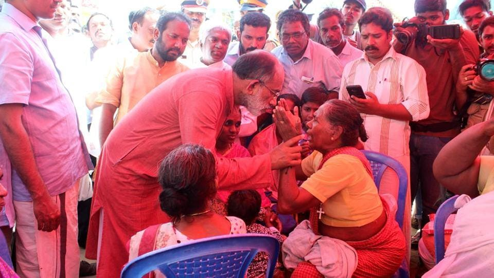 Union Minister of State for Electronics and Information Technology, Alphons Joseph met with the relatives of missing fishermen at Poonthura Coast in Thiruvananthapuram, Kerala, India on December 03, 2017. On Sunday, families of the fishermen blocked roads at several places and defied warnings by the met office and government, venturing out to look for them. (Vivek Nair / HT Photo)