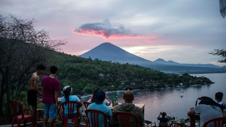 Tourists gather to watch Mount Agung at Amed beach in Karangasem on Indonesia's resort island of Bali last week.