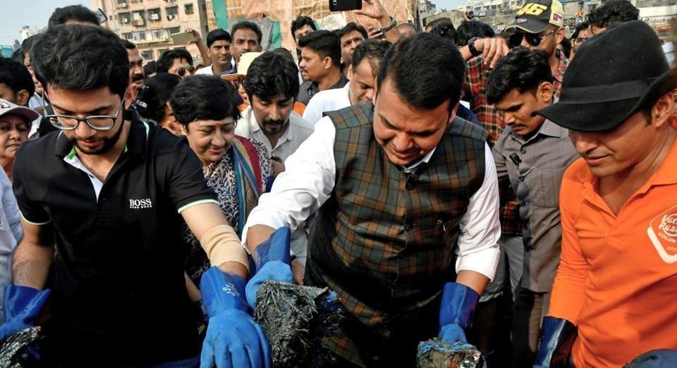 (From left) Yuva Sena chief Aaditya Thackeray, CM Devendra Fadnavis and Afroz Shah at Versova beach.
