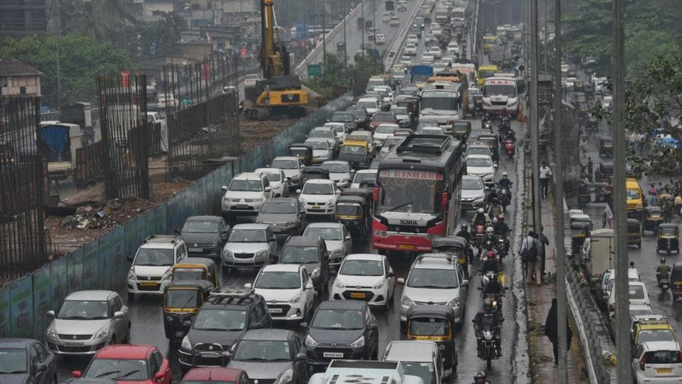 The traffic on Eastern and Western Express Highways in Mumbai has slowed down after rain in some parts of Mumbai. Police said some parts of the Mumbai-Pune Expressway also experienced a hailstorm early Tuesday. (Satyabrata Tripathy / HT Phtoto)