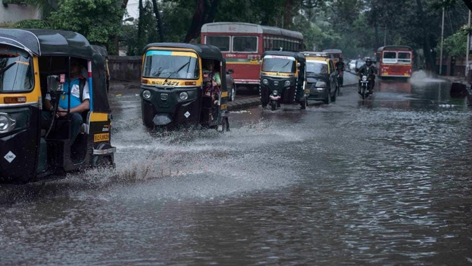 """Vehicles wade through a waterlogged street in Versova, Mumbai. According to IMD officials, """"It is moving further north-north-eastwards. It will weaken gradually into a deep depression by Tuesday night as it reaches the north Maharastra coast. (Satish Bate / HT Photo)"""