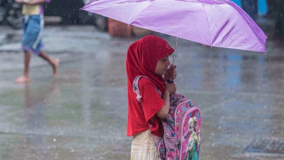"""Schools and colleges remained closed as a precautionary measure as per the Maharashtra government's order. According to KS Hosalikar, deputy director general, western region, IMD, """"heavy showers are expected in various areas along the Konkan coast."""" """"There will be heavy rain all along south Gujarat coast"""", he added.  (Satish Bate / HT Photo)"""