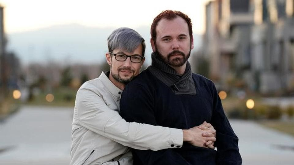 Gay married couple David Mullins (L) and Charlie Craig pose for a photo in Denver, Colorado.