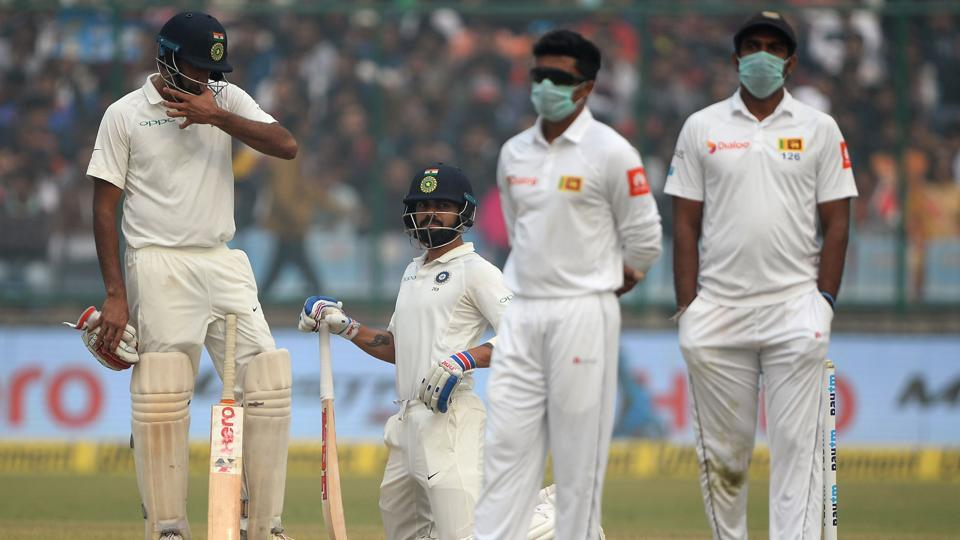 Sri Lanka cricket players wear masks in an attempt to protect themselves from air pollution during the India vs Sri Lanka third Test.