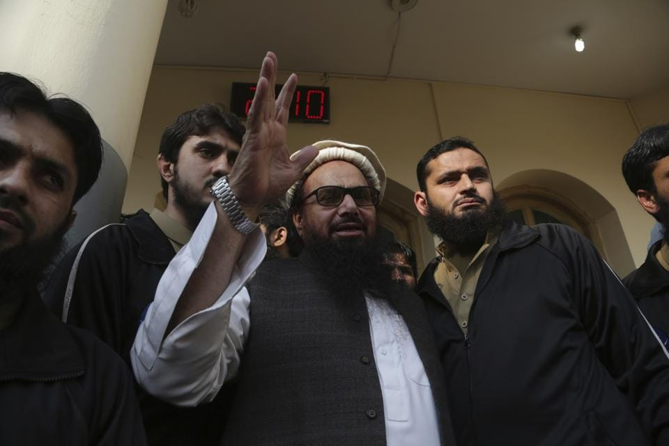 Hafiz Saeed waves to his supporters at a mosque in Lahore on November 24, 2017.