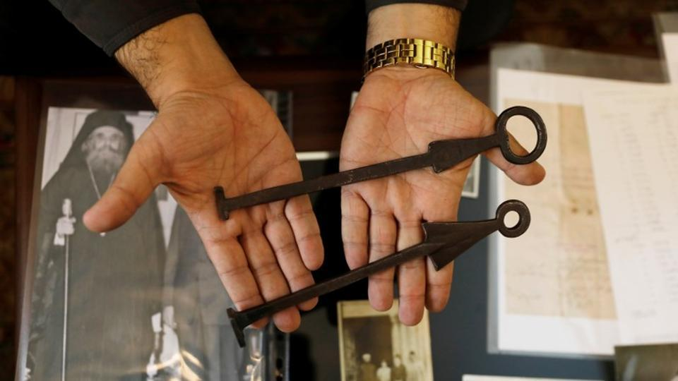 Adeeb Joudeh, displays the ancient keys to the Church of the Holy Sepulchre, at his home near Jerusalem's Old City. He dates the arrangement back to the time of Saladin, the Muslim conqueror who seized the holy city from the Crusaders in 1187. (Ronen Zvulun / REUTERS)