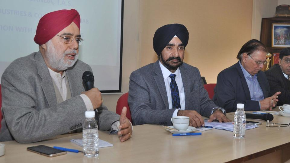 Industrialist Onkar Singh Pahwa (left) speaking during a meeting in Ludhiana on Monday.