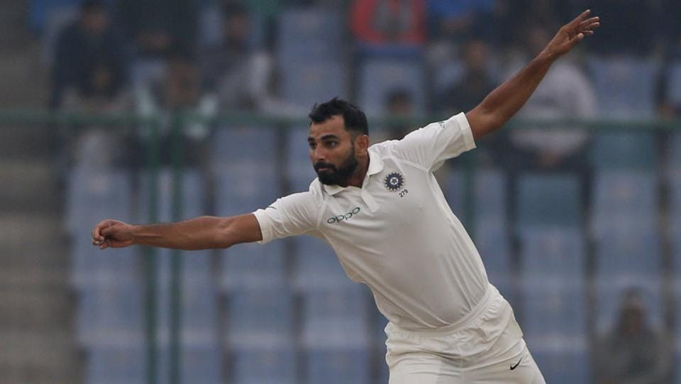 Mohammed Shami attempts to stop the ball during the fourth day of the third Test match against Sri Lanka in New Delhi. Shami had to leave the field after air pollution caused him to vomit.