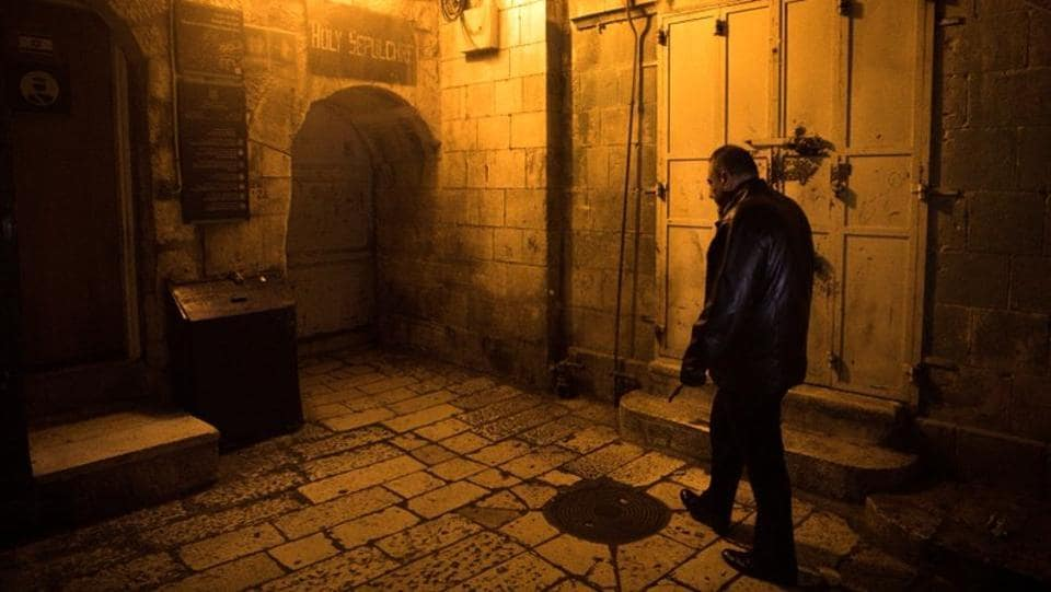 Adeeb Joudeh, the custodian of the ancient key to the Church of the Holy Sepulchre, walks as he holds the church key in Jerusalem's Old City. Centuries ago, the imposing iron key was entrusted to his family, one of Jerusalem's most prominent clans, says Joudeh. (Ronen Zvulun / REUTERS)
