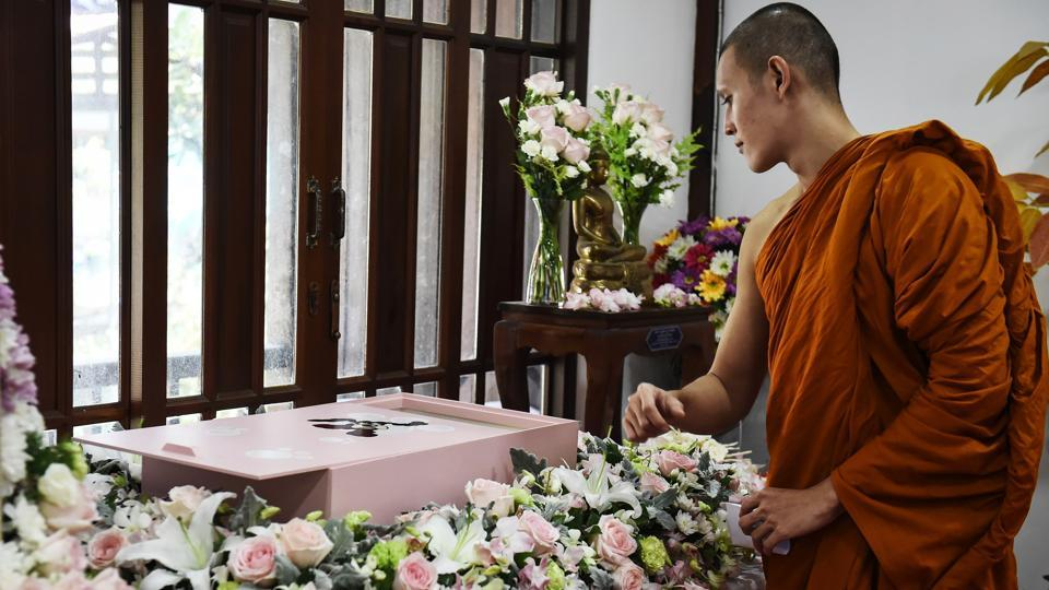 A Buddhist monk blesses the body of Dollar, a six-year-old Shitzu dog, during her funeral at Wat Krathum Suea Pla Buddhist temple in Bangkok. Pet cremations, complete with Buddhist rituals, are popping up across Bangkok for dogs, cats and even monkeys. In the devout Buddhist kingdom some pet owners believe the monk-led send off will boost their pets' chances of being reincarnated as a higher being. (Lillian Suwanrumpha / AFP)