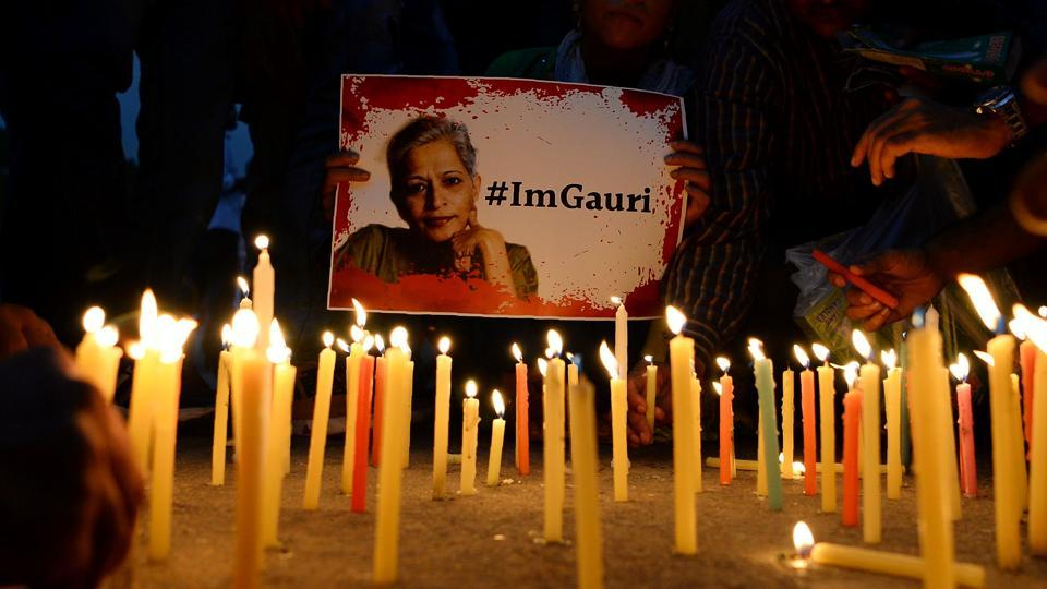 Activists take part in a protest rally against the killing Gauri Lankesh at the India Gate memorial in New Delhi.