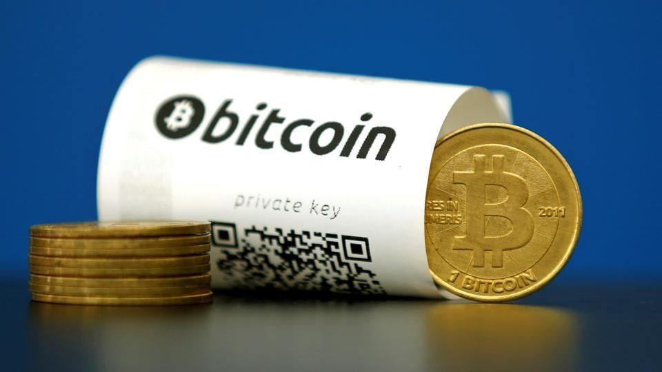A Bitcoin (virtual currency) paper wallet with QR codes and a coin seen in an illustration picture.