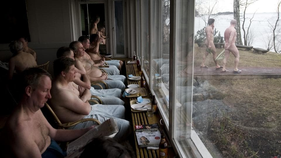 Finnish men resting as they spend the day at Helsinki's Suomen Saunaseura (the Finnish Sauna Society). (AFP)