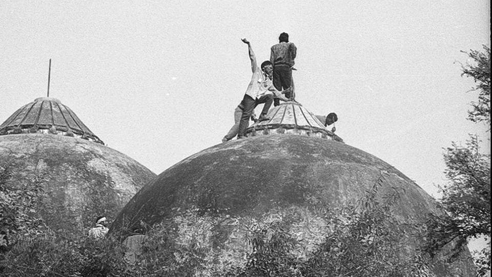File photo of people climbing the Babri Masjid in Ayodhya on the day it was demolished.