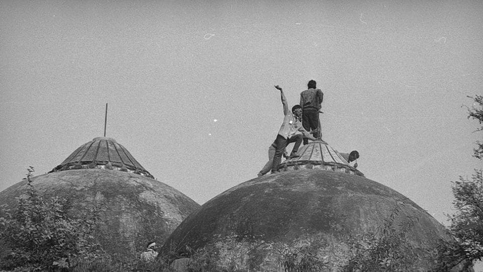 People climb atop Babri Masjid the day it was demolished in Ayodhya, Uttar Pradesh on December 06, 1992. The Babri Masjid-Ram Janmabhoomi case has been going on for a quarter of a century but the dispute itself is over a century old. On the eve of the 25th anniversary of the demolition, the Supreme Court said it will hear appeals regarding the Ramjanmabhoomi-Babri Masjid dispute in February 2018. The belief is that the birthplace of Lord Rama is located under the mosque's central dome. (Sanjay Sharma / HT Photo)