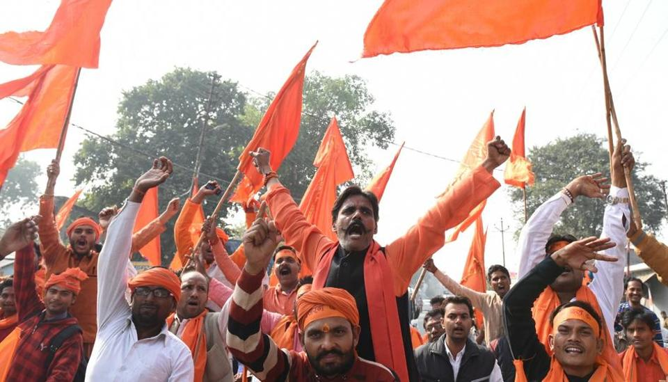 Protesters take part in a motorcycle rally near Ram Janmabhoomi in Ayodhya to mark the 25th anniversary of Babri Masjid demolition on Wednesday.