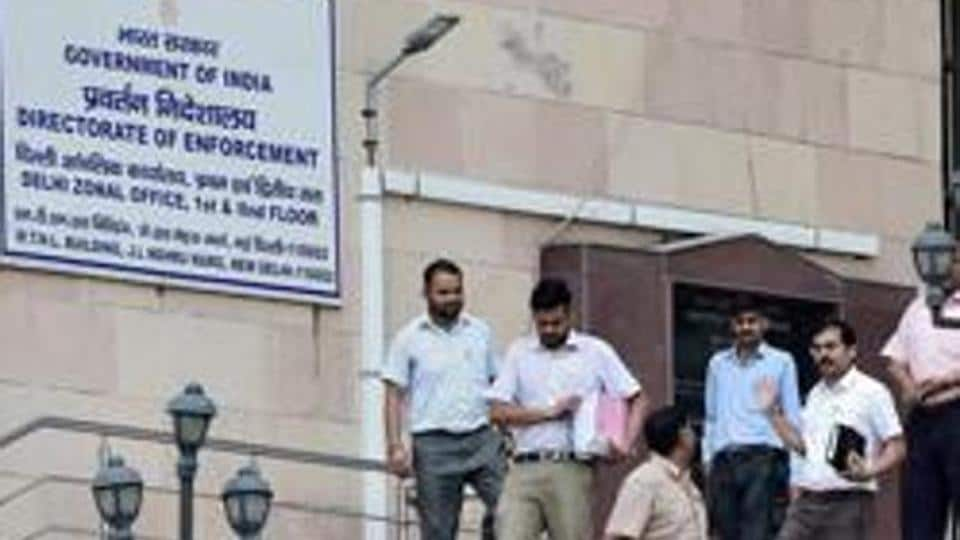 Officials at the Directorate of Enforcement office in front of the agency's office in New Delhi.
