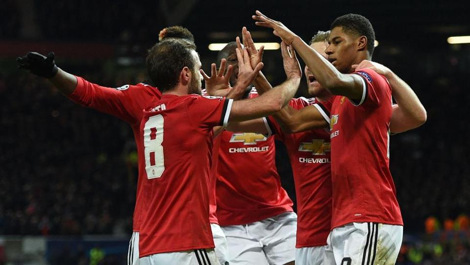 Manchester United's Marcus Rashford (R) celebrates after scoring their second goal during the UEFA Champions League Group A match against CSKA Moscow at Old Trafford in Manchester.
