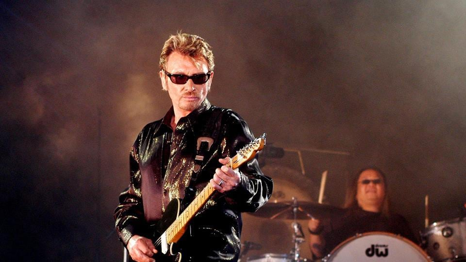 This file photo taken on May 25, 2003 shows French singer Johnny Hallyday performing in Saint-Denis-de-la-Réunion France's best-known rock star Johnny Hallyday has died aged 74 after a battle with lung cancer.