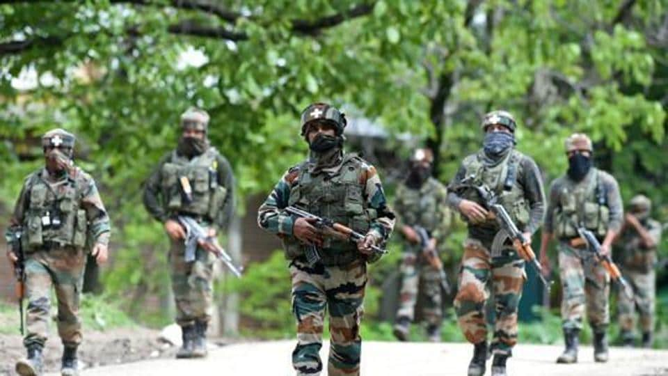 Indian army soldiers conduct a patrol during an operation against suspected rebels near Srinagar.  Apart from action on the nation's frontiers, counter-insurgency operations across states hit by separatist movements and social unrest often leave many a soldier's family without a breadwinner.