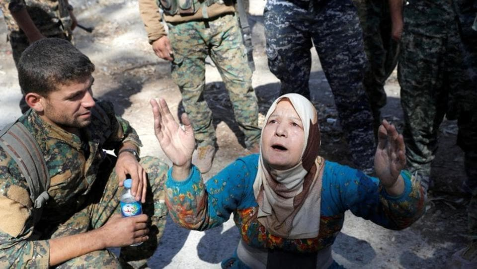 A civilian prays after being rescued by Syrian Democratic Forces from the stadium after Raqqa was liberated from the Islamic in October 2017. ISIS presented themselves as saviours. But as jihadists brandishing AK-47 rifles began imposing an Islamist doctrine even more brutal and medieval than al Qaeda, their popularity soon faded. (Erik De Castro / REUTERS)